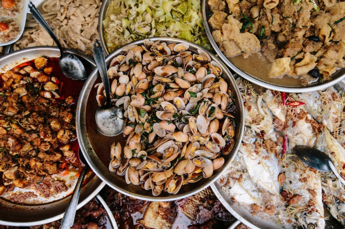 Various seafood dishes for sale at a street food stall, Chinatown, Bangkok, Thailand