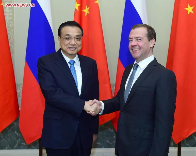 Chinese Premier Li Keqiang and his Russian counterpart, Dmitry Medvedev, on Monday vowed to enhance pragmatic cooperation between the two neighbors.