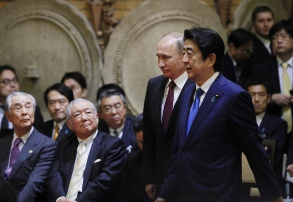 """Putin said he did not know how the dispute could be resolved, but he said the islands should be seen not as a point of contention point but """"a place that brings Japan and Russia together."""""""